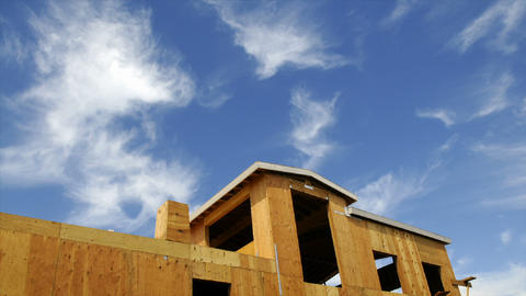 Time-lapse of clouds blowing above a house under... Stock Video Footage