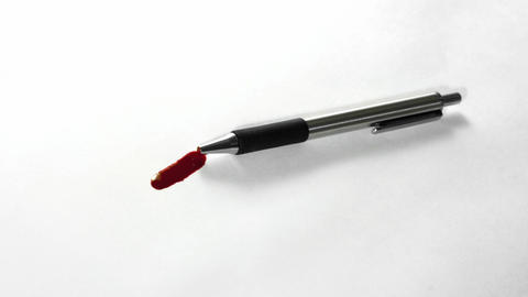 Time lapse of a pen bleeding red ink Stock Video Footage
