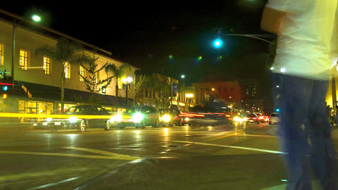 Time lapse of a busy city street intersection at night Footage