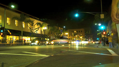 Time lapse of a busy city street intersection at night Stock Video Footage