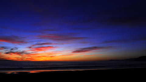 Time lapse of a colorful sunset over the ocean Stock Video Footage