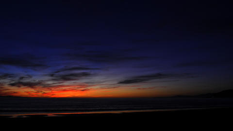 Time lapse of a colorful sunset over the ocean Footage