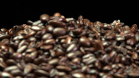 A rack focus of a pile of roasted coffee beans Footage