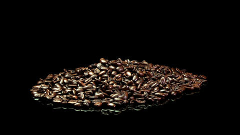A distant shot of a pile of roasted coffee beans slowly... Stock Video Footage