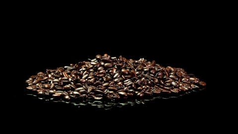 A distant shot of a pile of roasted coffee beans slowly rotating Footage