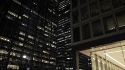 Pan low angle aerial shot of skyscrapers in NYC New York City Manhattan night st Footage