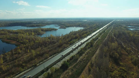Aerial footage of road and people traveling by cars on a highway Footage