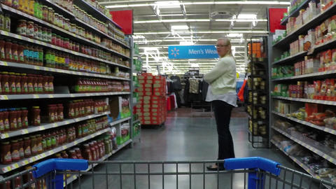 Woman shopping grocery isle shopping cart HD POV 870 Footage
