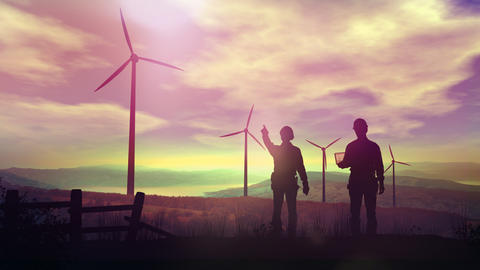 Silhouettes of engineers watching wind farms at sunset Fotografía