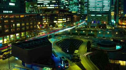A timelapse of cityscape at the urban city in front of Tokyo station panning Live Action