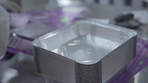 Preparation of ready metal food containers for sale. Top view of foil food Live Action