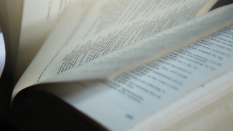 Slow motion of flipping through the pages of a book Live Action
