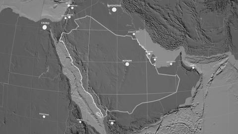 Zoom-in on Saudi Arabia outlined. Grayscale contrasted Animation