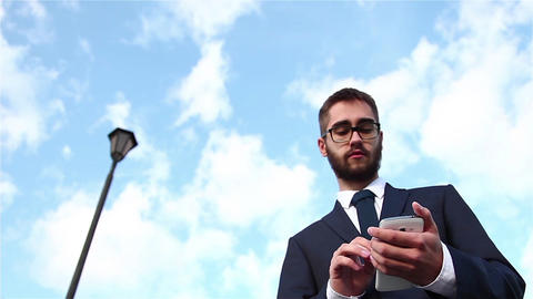 Man Using a Smartphone and Social Notification Icons Live Action