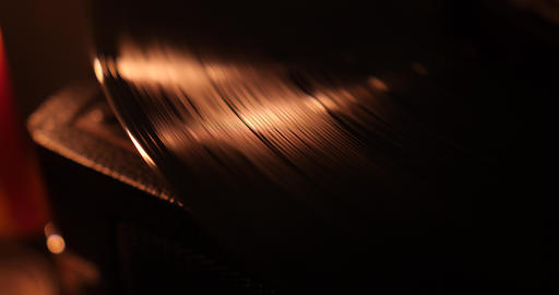 Vinyl record playing at candle light Live Action