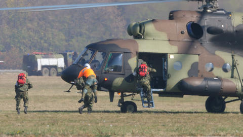 Serbian Soldiers Jump Into Russian Military Helicopter during Military Exercise Live Action