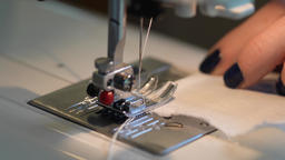 Sewing on a sewing machine. Close up of a carriage and a needle Live Action
