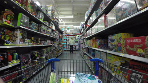 Shopping woman in kids toy and games department POV 4K 883 Footage