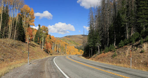 Car travel mountain road autumn fall colors DCI 4K 685 Footage