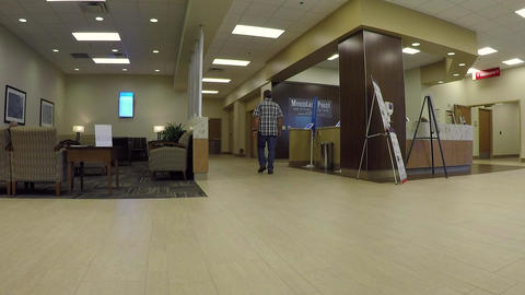 Man walks away waiting area entrance hospital HD 842 Footage