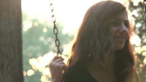 Beautiful girl swinging Footage