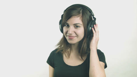 Attractive young woman listening to music on headphones Footage