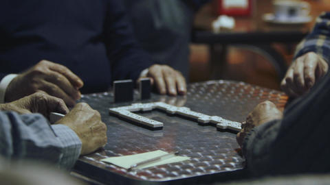 Old men playing dominoes Footage