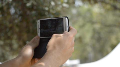 Man Recording Event On Mobile Phone Footage