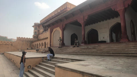Jaipur, India, November 05, 2019, Amer Fort, tourists relax on the stairs after Live Action