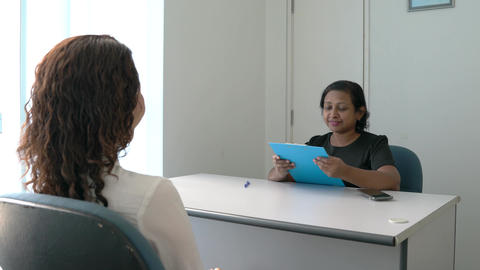 Recruiter or Job Interviewer conducting an interview with a job seeker in an office room. Employment Live Action