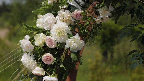 Wedding decorator decorates the place of registration of marriage with fresh Live Action