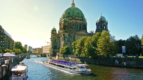 Tourist boat in the Spree river and the Berlin Cathedral Footage