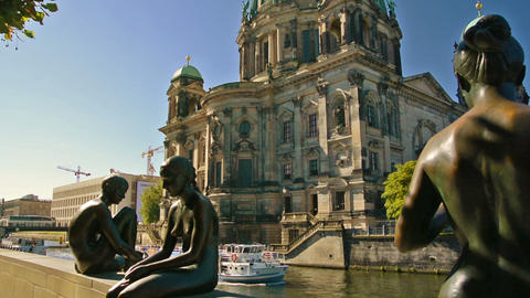Statues along the Spree river bank opposite the Berlin Cathedral Footage
