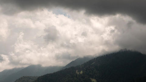 Rain clouds in the mountains. Panorama. TimeLapse. Krasnaya Polyana. Sochi, Russ Footage