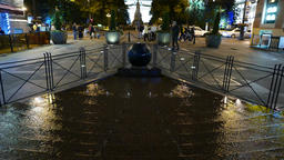 Cascade fountain with granite kugel ball on Malaya Sadovaya street at night Footage