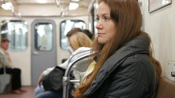 Tired young woman ride alone in subway car, portrait shot Live Action