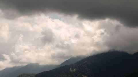 Mountainside in clouds. Zoom. Ridge Aibga, Time Lapse. Krasnaya Polyana, Sochi,  Footage