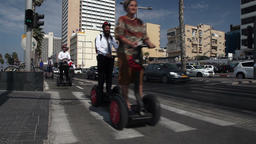 Tel - Aviv, Israel – October 26, 2016: Group of tourists on a segway rides alo Footage