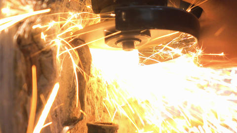 Man Used Circular Cutting Machine is Cut the Pipe with Lot of Sparks, closeup Footage