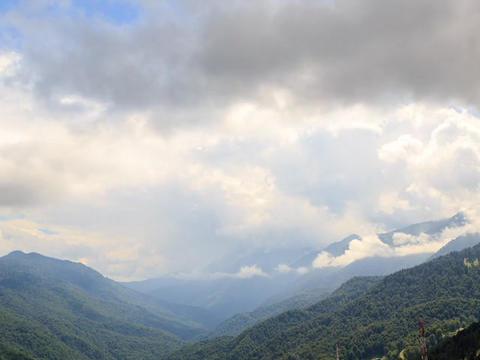 Mountainside in clouds. Zoom. Ridge Aibga, Time Lapse. Krasnaya Polyana, Sochi,  Footage