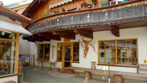 Typical painted houses in the historic district of Oberammergau in Bavaria - Live Action