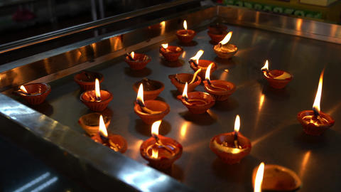 Colorful Diwali oil lamps in a Hindu temple. Diwali or religious celebration Live Action