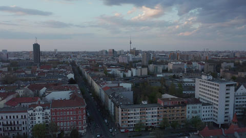 AERIAL: Beautiful Wide View over Dark Berlin Cityscape during Sunset with Live Action