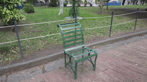 Green bench for one person in the park in Salerno - Pan Live Action