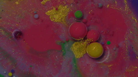 Abstract colorful bubbles. Macro colors, paint in dynamic flow. Exploding and changing forms. Top Live Action