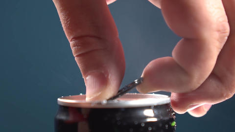 man opens an aluminum can with a drink Live Action