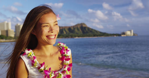 Hawaii travel beach vacation - woman smiling happy wearing Hawaiian flower Lei Live Action