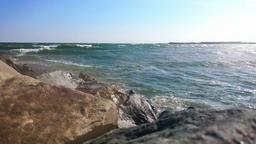 Waves breaking on rock shore Footage