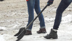 People clean streets with shovels after heavy snowfall Footage