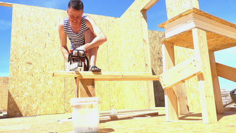 Man builds a wooden house Footage